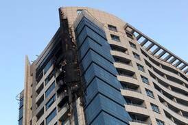 Dubai Marina fire: forensics probe scene as 60 residents moved to hotel