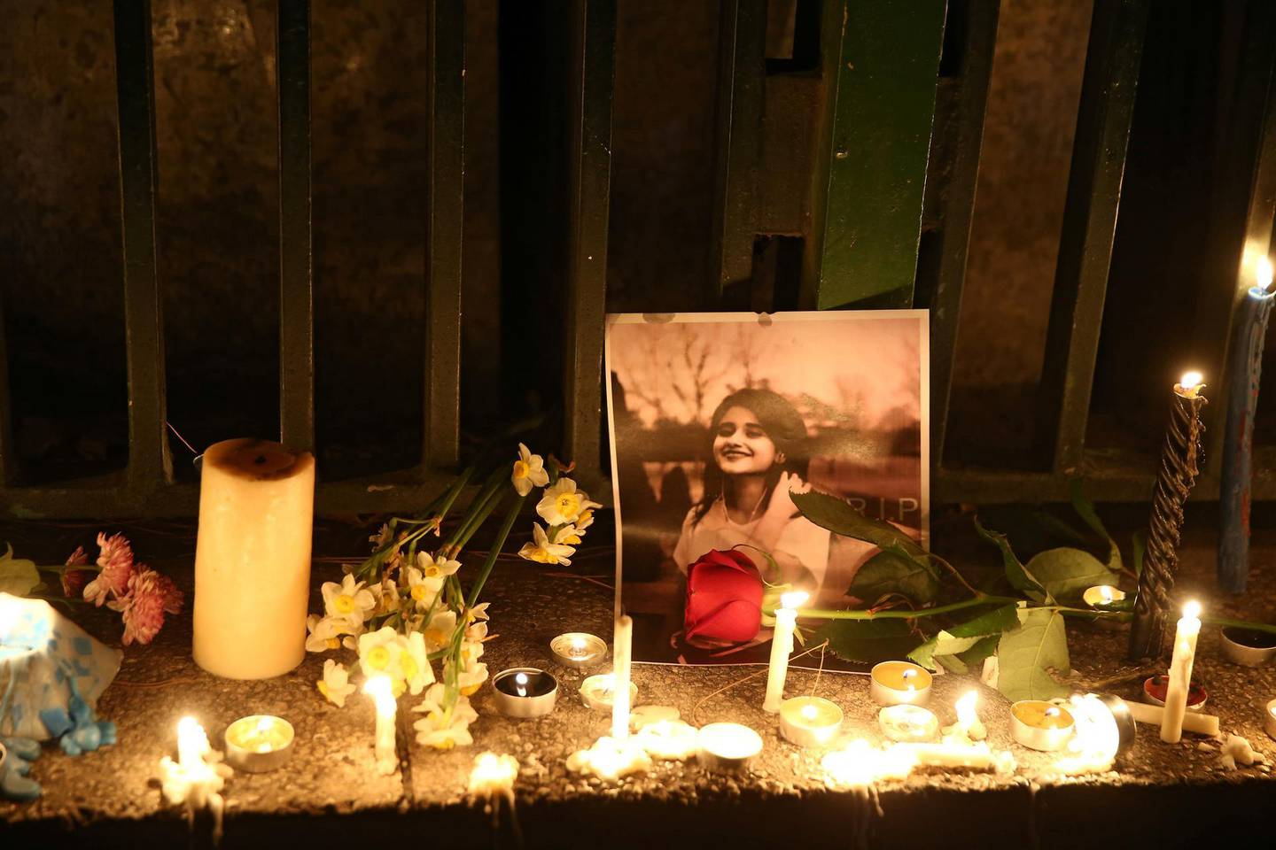 A picture is seen next to candles lit by people and families of the victims of the crash of the Boeing 737-800 plane, flight PS 752, in Tehran, Iran January 11, 2020. Nazanin Tabatabaee/WANA (West Asia News Agency) via REUTERS ATTENTION EDITORS - THIS IMAGE HAS BEEN SUPPLIED BY A THIRD PARTY