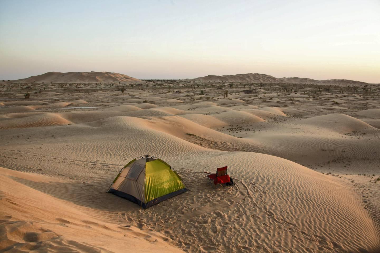 """Tent in the Rub al Khali desert Oman during sunset,"""