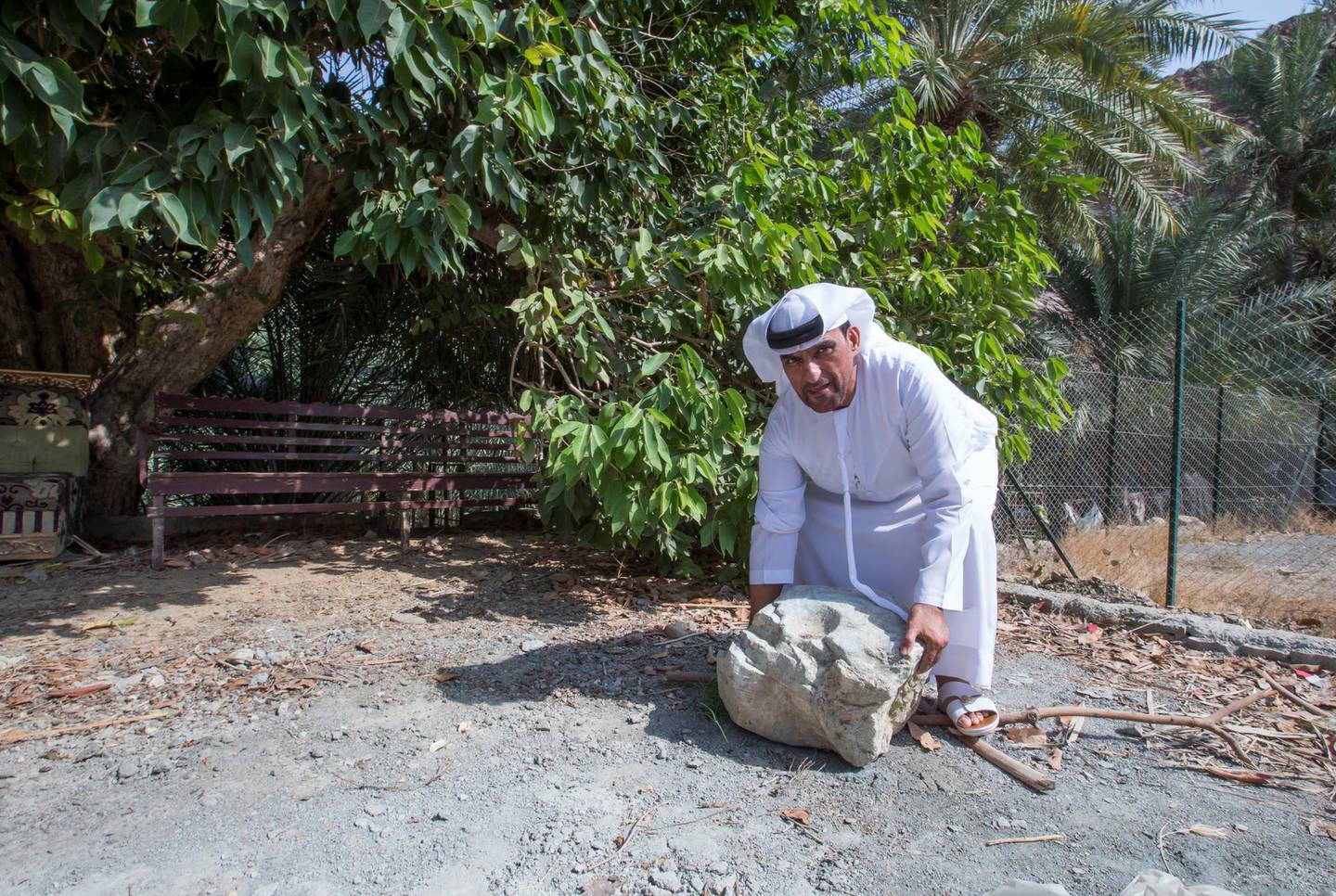 Sharjah, United Arab Emirates-  Abdullah Khilfan Al Naqbi with the marriage rock.  It was believed before that if a man wants to marry the woman, he has to lift this rock at Al Nahwa Village in Sharjah.  Leslie Pableo for The National for Ruba Haza