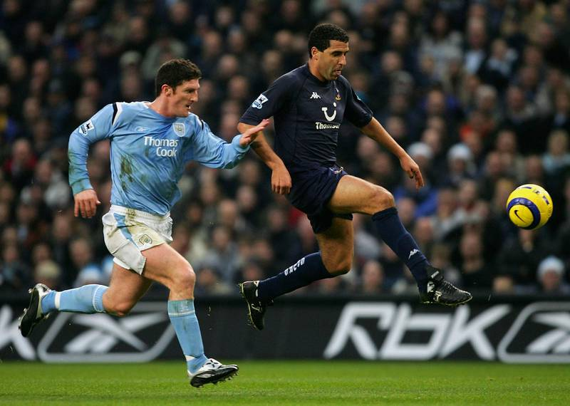 MANCHESTER, ENGLAND - DECEMBER 11:  Noureddine Naybet of Tottenham Hotspur beats Jon Macken of Manchester City during the Barclays Premiership match between Manchester City and Tottenham Hotspur at the City of Manchester Stadium on December 11, 2004 in Manchester, England.  (Photo by Alex Livesey/Getty Images)