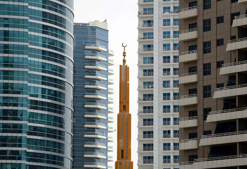 Dubai, United Arab Emirates - Reporter: N/A. News. A minaret stands tall among the skyscrappers in Barsha Heights. Sunday, April 18th, 2021. Dubai. Chris Whiteoak / The National