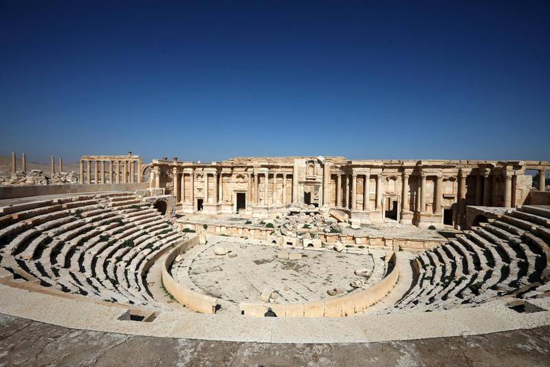 A picture shows a partial view of the damaged amphitheatre, in Syria's Roman-era ancient city of Palmyra on February 7, 2021, in the country's central province of Homs. - Syria has six sites listed on the UNESCO elite list of world heritage and all of them sustained some level of damage in the 10-year war. Besides Palmyra and Aleppo, the ancient cities of Damascus and Bosra also sustained some damage. (Photo by LOUAI BESHARA / AFP)