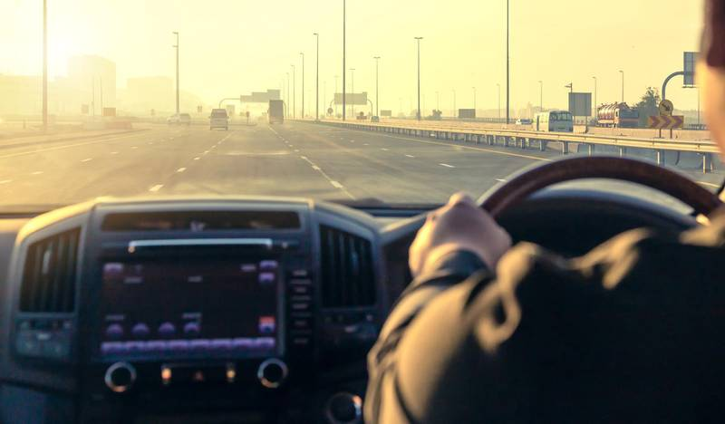 Inside the car, driving on the highway at sunset in Dubai UAE. Getty Images