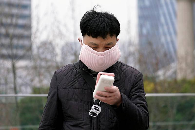 A man wearing a handmade face mask is seen in Shanghai, China, as the country is hit by a novel coronavirus outbreak, at the Pudong financial district in Shanghai, China February 28, 2020. REUTERS/Aly Song
