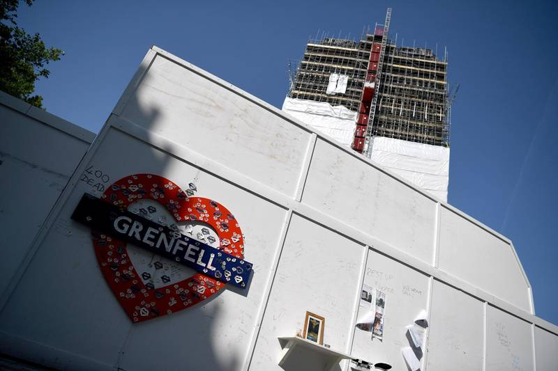 epa06752063 The remains of the Grenfell tower in London, Britain, 20 May 2018. At least 71 people died in a fire that broke out at Grenfell Tower on 14 June 2017. A public inquiry into the disaster chaired by Sir Martin Moore-Bick will begin on 21 May 2018.  EPA/NEIL HALL
