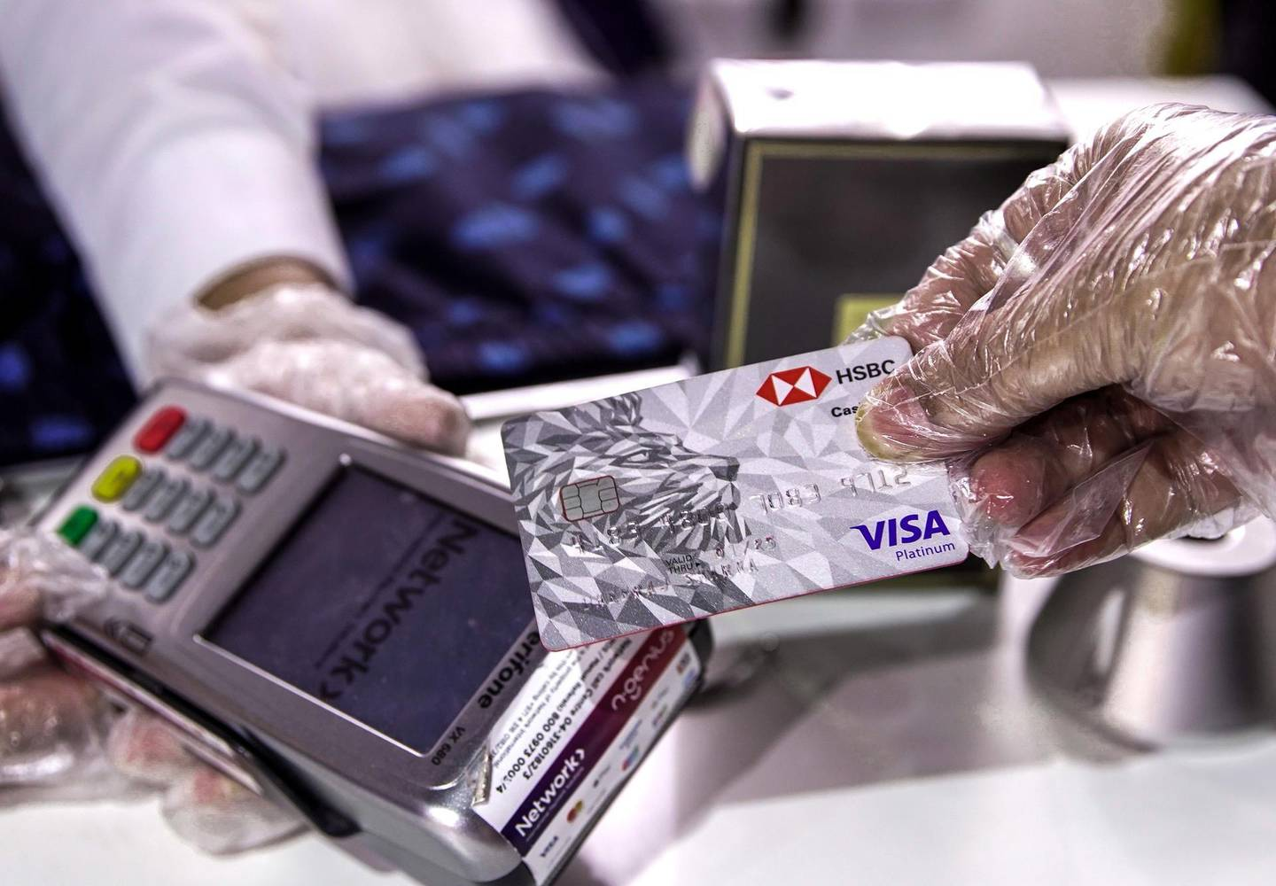 Abu Dhabi, United Arab Emirates, May 18, 2020.    Cashless payments at the Al Raha Mall on the first day of reopening during the Covid-19 pandemic.Victor Besa / The NationalSection:  NAReporter: