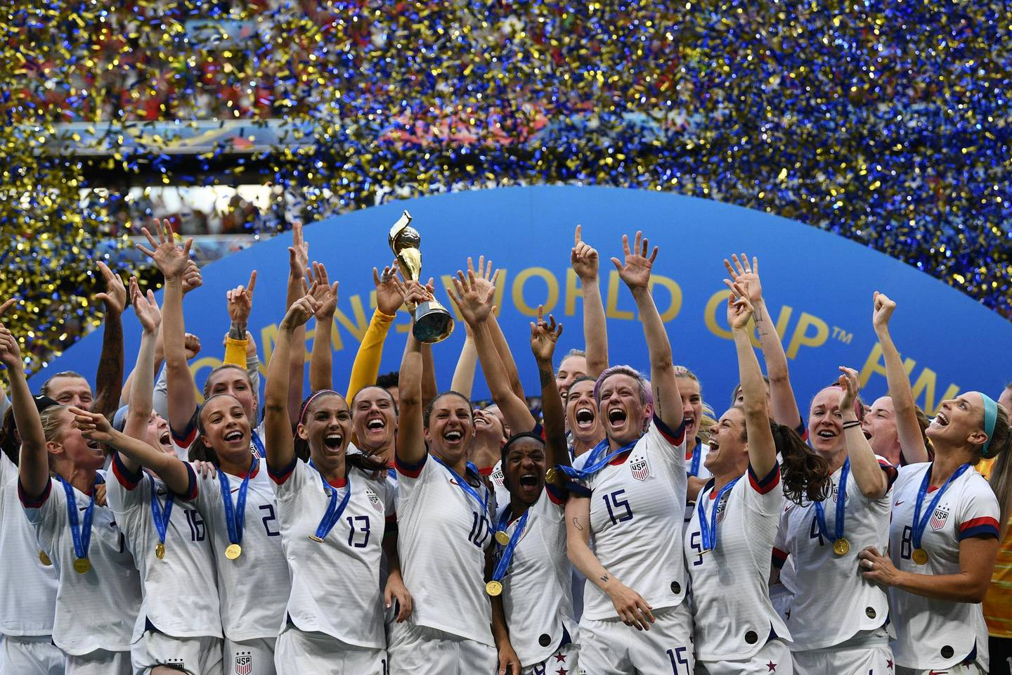 USA's players celebrate with the trophy after the France 2019 Women's World Cup football final match between USA and the Netherlands, on July 7, 2019, at the Lyon Stadium in Lyon, central-eastern France. (Photo by FRANCK FIFE / AFP)