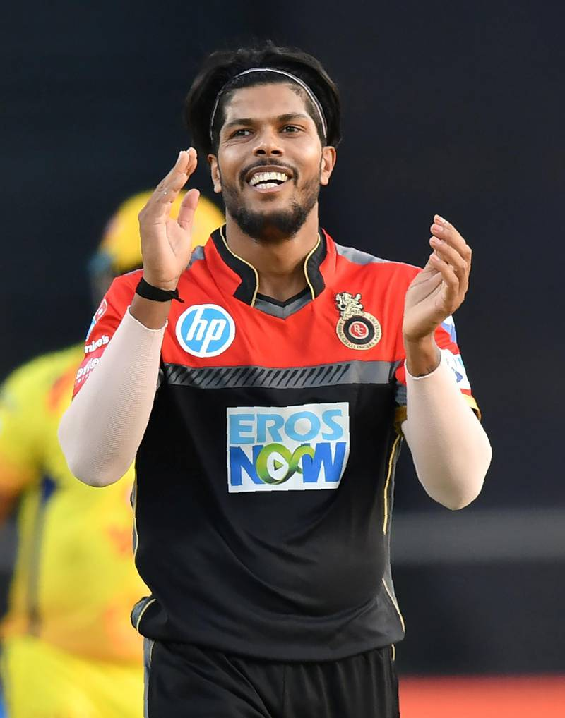 Royal Challengers Bangalore cricketer Umesh Yadav celebrates after taking the wicket of Chennai Super Kings batsman Suresh Raina during the 2018 Indian Premier League (IPL) Twenty20 cricket match between Chennai Super Kings and Royal Challengers Bangalore at the Maharashtra Cricket Association Stadium in Pune on May 5, 2018. / AFP PHOTO / PUNIT PARANJPE / ----IMAGE RESTRICTED TO EDITORIAL USE - STRICTLY NO COMMERCIAL USE----- / GETTYOUT