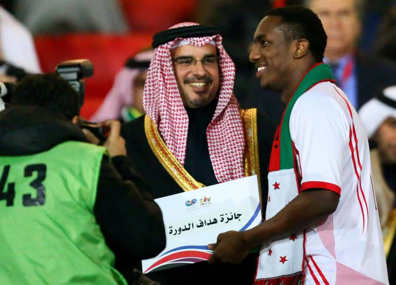 Emarati player Ahmad Khalil (R) receives the best scorer diploma for the 21st Gulf Cup from Bahraini Crown Prince Salman bin Hamad bin Isa Al Khalifa at the end of the Cup's final on January 18, 2013 in Manama. United Arab Emirates won 2-1 against  Iraq.  AFP PHOTO/MARWAN NAAMANI  *** Local Caption ***  291331-01-08.jpg