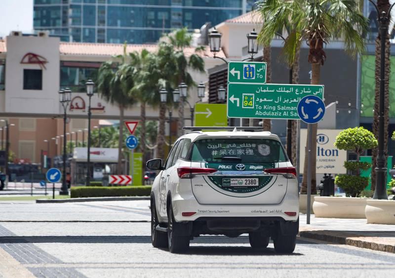Dubai, United Arab Emirates - Reporter: N/A: Corona. A police car patrols an empty JBR. Tuesday, April 14th, 2020. Dubai. Chris Whiteoak / The National