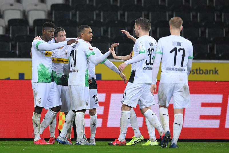 MOENCHENGLADBACH, GERMANY - MARCH 11: Breel Embolo of Borussia Monchengladbach celebrates his sides second goal with Alassane Plea, Stefan Lainer, Raffael and other team mates after a 1. FC Koeln own goal during the Bundesliga match between Borussia Moenchengladbach and 1. FC Koeln at Borussia-Park on March 11, 2020 in Moenchengladbach, Germany. For the first time in the history of the German Bundesliga the match is played behind closed doors as a precaution against the spread of COVID-19 (Coronavirus). (Photo by Jörg Schüler/Bongarts/Getty Images)