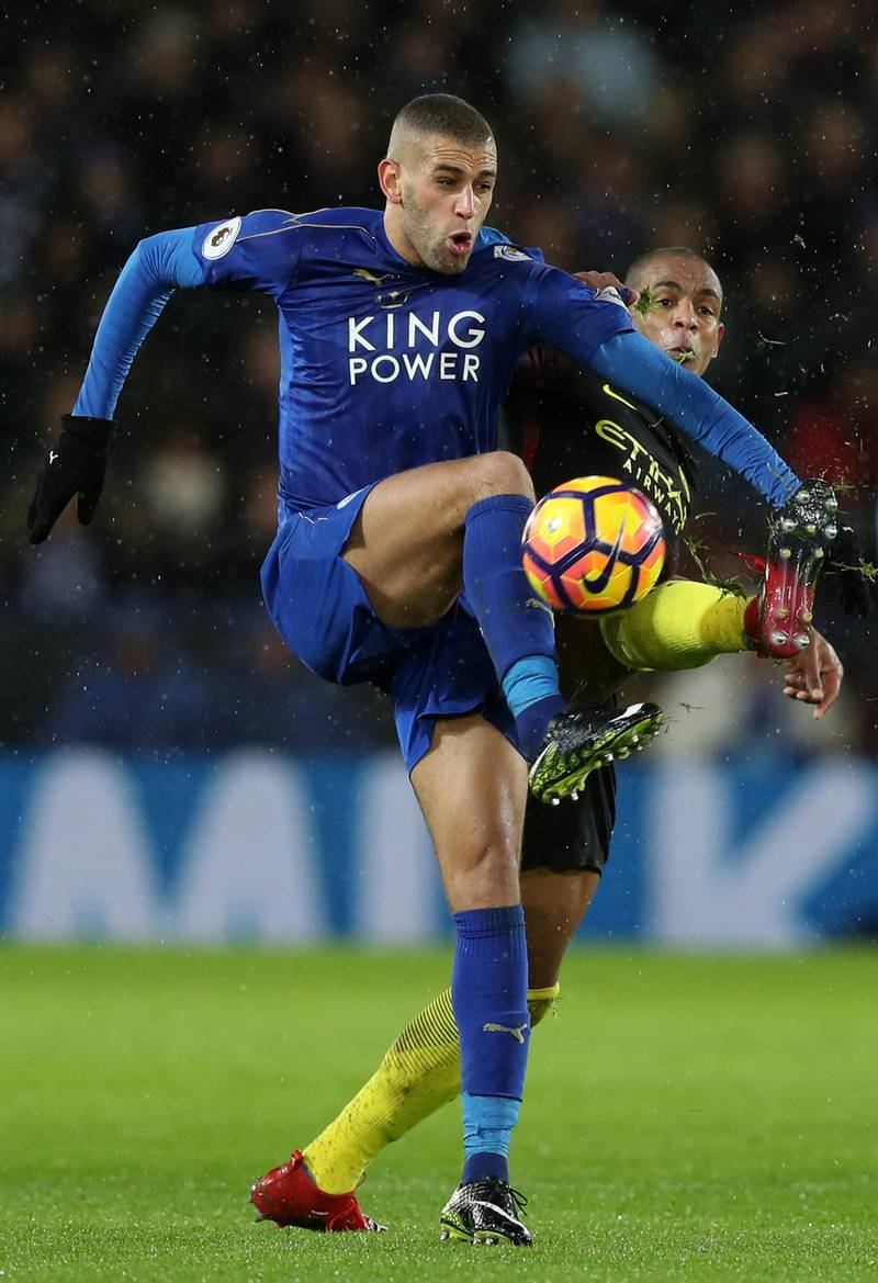 LEICESTER, ENGLAND - DECEMBER 10: Islam Slimani of Leicester City (L) and Fernando of Manchester City (R) battle for possession during the Premier League match between Leicester City and Manchester City at the King Power Stadium on December 10, 2016 in Leicester, England.  (Photo by Christopher Lee/Getty Images)