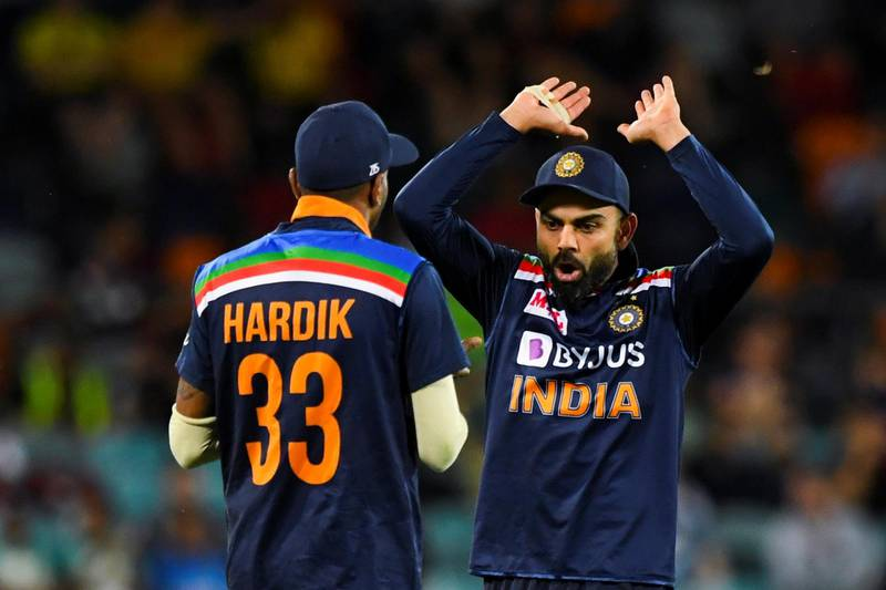 Virat Kohli of India (R) celebrates with teammate Hardik Pandya of India after claiming the wicket of Aaron Finch of Australia during the first T20 cricket match between Australia and India at Manuka Oval in Canberra, Australia, December 4, 2020.  AAP Image/Lukas Coch via REUTERS  ATTENTION EDITORS - THIS IMAGE WAS PROVIDED BY A THIRD PARTY. NO RESALES. NO ARCHIVE. AUSTRALIA OUT. NEW ZEALAND OUT