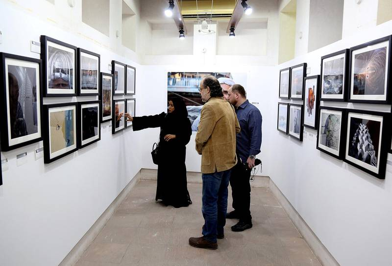 Dubai, March 20, 2018: Visitors take a look at the Photographs displayed by UAE photographers at the Sikka Art fair at Al Fahidi Historical District in Dubai. Satish Kumar for the National