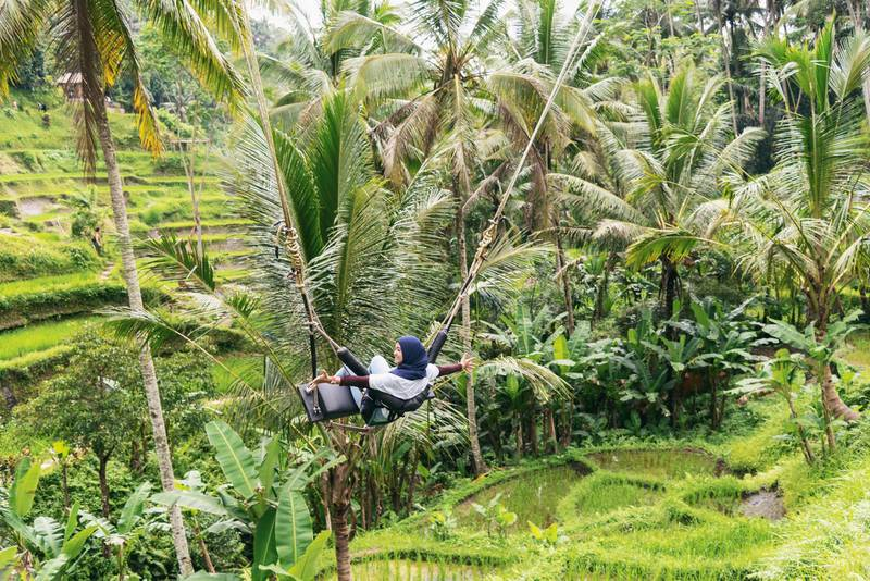Teenager swinging Over in Tegallalang Ubud. Getty Images