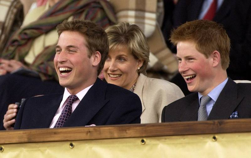 FILE - In this Monday, June 3, 2002 file photo, Britain's Prince William and Prince Harry enjoy the Party at the Palace concert in the gardens of Buckingham Palace, London, as the second concert to commemorate the Golden Jubilee of Britain's Queen Elizabeth II. Britain's royal officials said Thursday April 26, 2018, Prince Harry has asked elder brother Prince William to be best man at his wedding when he marries U.S. actress Meghan Markle at Windsor Castle on May 19. (AP Photo/Arthur Edwards/Pool)