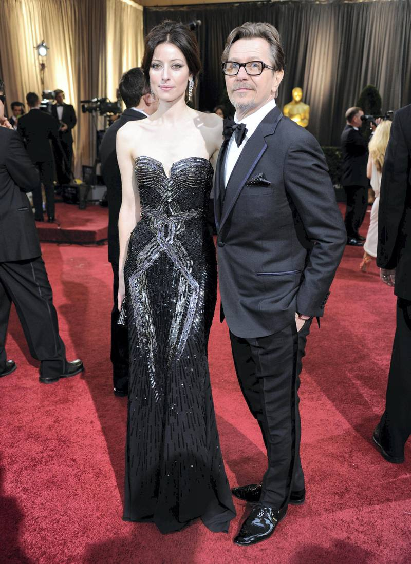 HOLLYWOOD, CA - FEBRUARY 26: Actor Gary Oldman (R) and Alexandra Edenborough arrive at the 84th Annual Academy Awards held at the Hollywood & Highland Center on February 26, 2012 in Hollywood, California.   Ethan Miller/Getty Images/AFP