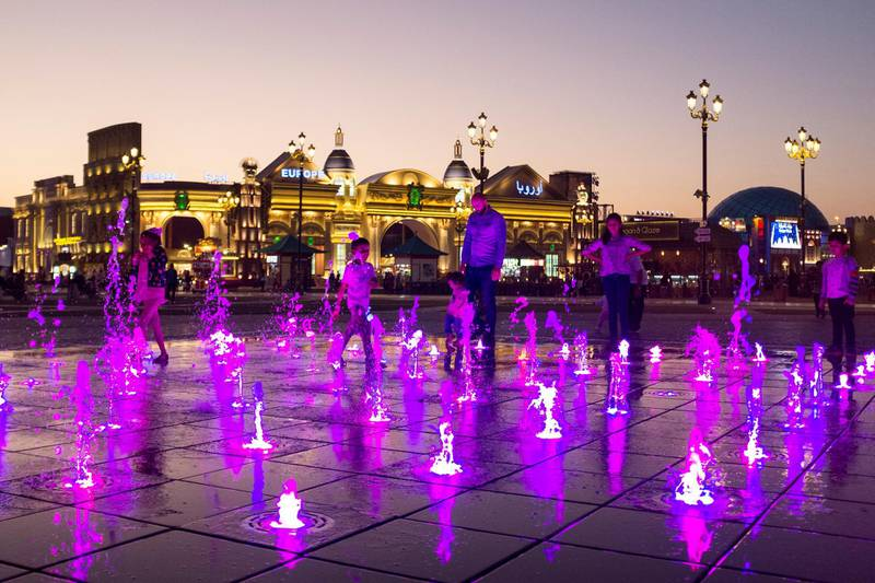 DUBAI, UNITED ARAB EMIRATES - DECEMBER 8, 2018.   Visitors  by the dancing fountain at Global Village.  (Photo by Reem Mohammed/The National)  Reporter:  Section:  NA