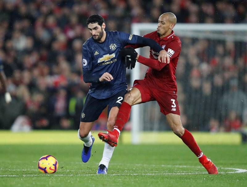 """Soccer Football - Premier League - Liverpool v Manchester United - Anfield, Liverpool, Britain - December 16, 2018  Manchester United's Marouane Fellaini in action with Liverpool's Fabinho   Action Images via Reuters/Carl Recine  EDITORIAL USE ONLY. No use with unauthorized audio, video, data, fixture lists, club/league logos or """"live"""" services. Online in-match use limited to 75 images, no video emulation. No use in betting, games or single club/league/player publications.  Please contact your account representative for further details."""