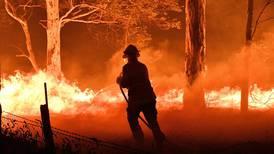 Families battle flames or flee Australia's raging bushfires