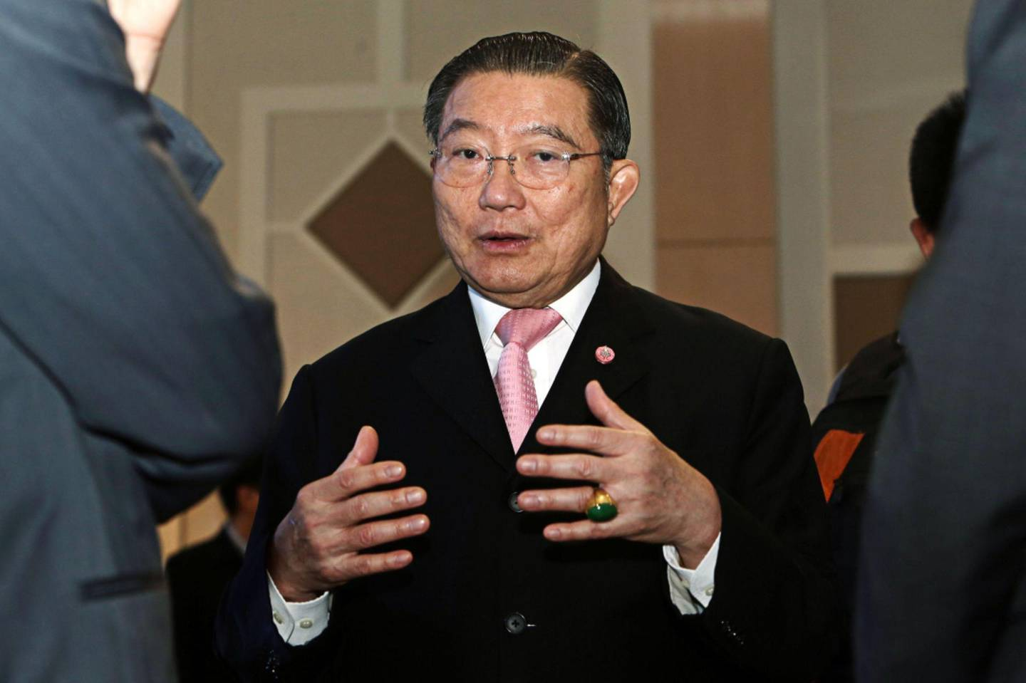 Billionaire Charoen Sirivadhanabhakdi, chairman of Thai Beverage Pcl, speaks with guests as he attends a charity event in Bangkok, Thailand, on Wednesday, Oct. 15, 2014. Charoen is Thailand's richest man with a $12.7 billion fortune, according to the Bloomberg Billionaires Index. He controls an empire whose businesses span industries from beer to property development. Photographer: Dario Pignatelli/Bloomberg *** Local Caption *** Charoen Sirivadhanabhakdi