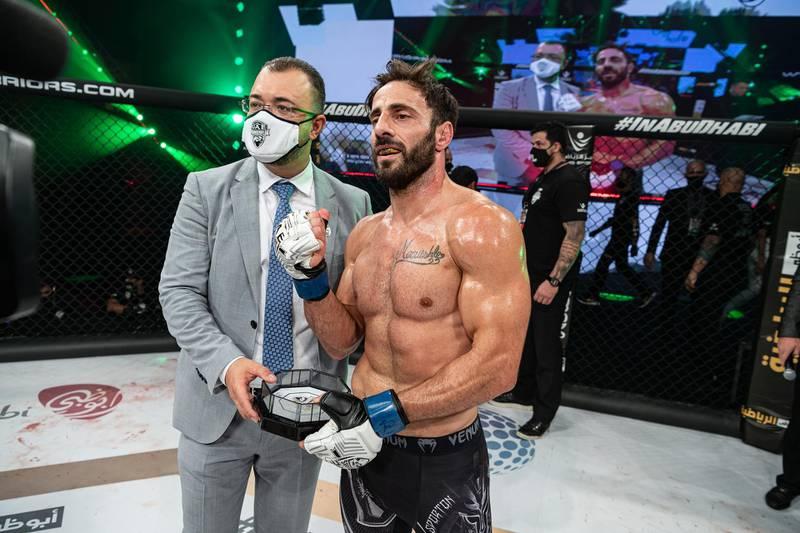 Gianni Melillo receives his award from Fouad Darwish, managing director of Palms Sports, in the UAE Warriors 20 at the Jiu-Jitsu Arena in Abu Dhabi on Saturday, June 19, 2021. Photo: UAE Warriors