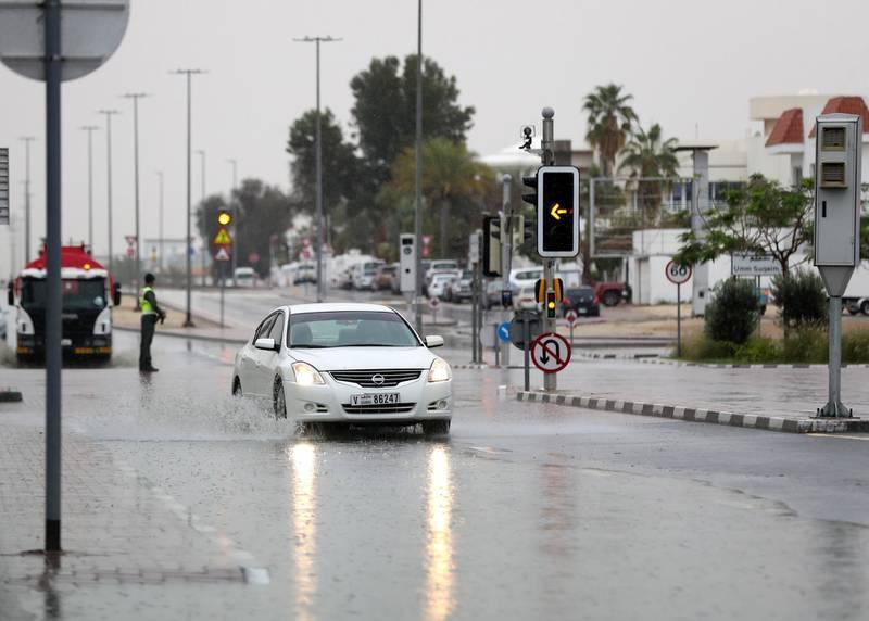 Dubai, United Arab Emirates - Reporter: N/A: Weather. Cars go through puddles as the rain comes down in Dubai. Saturday, March 21st, 2020. Jumeirah, Dubai. Chris Whiteoak / The National