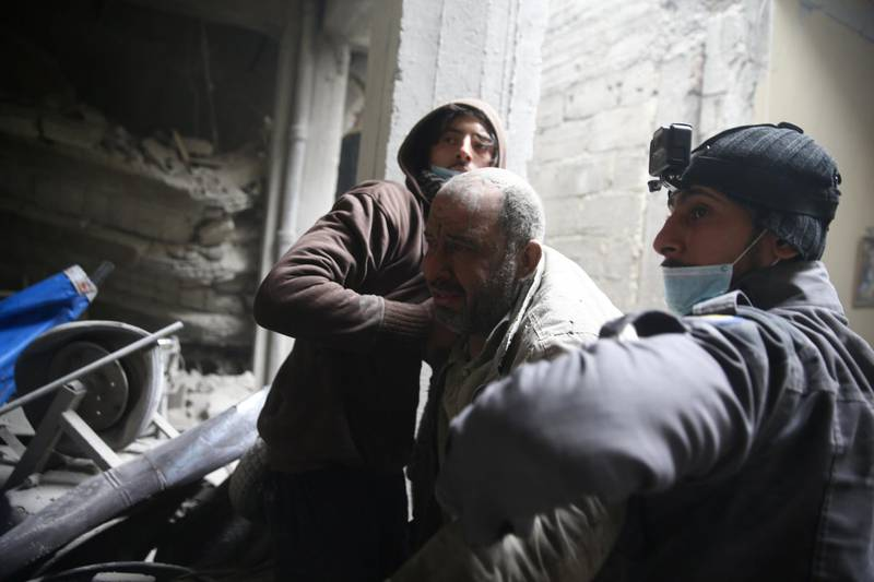 Abu Mohammad Alaya, 50, is helped out from shelter in Douma, Syria February 22, 2018. Picture taken February 22, 2018. REUTERS/Bassam Khabieh