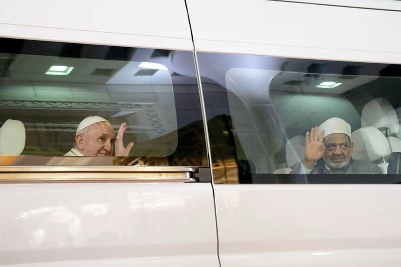 ABU DHABI, UNITED ARAB EMIRATES - February 03, 2019: Day one of the UAE papal visit - His Holiness Pope Francis, Head of the Catholic Church (L) and His Eminence Dr Ahmad Al Tayyeb, Grand Imam of the Al Azhar Al Sharif (R), bid farewell while departing from the Presidential Airport, after being received by HH Sheikh Mohamed bin Zayed Al Nahyan, Crown Prince of Abu Dhabi and Deputy Supreme Commander of the UAE Armed Forces (not shown).   ( Mohamed Al Hammadi / Ministry of Presidential Affairs ) ---
