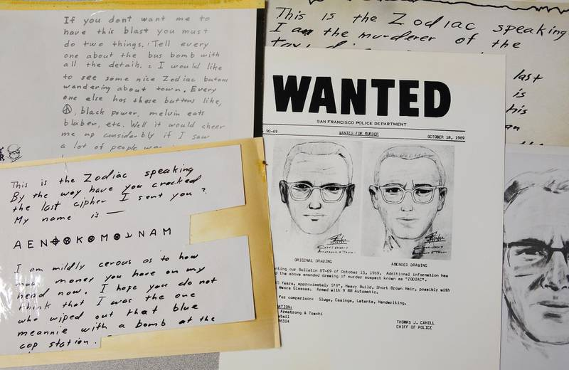 FILE - In this May 3, 2018, file photo, a San Francisco Police Department wanted bulletin and copies of letters sent to the San Francisco Chronicle by a man who called himself Zodiac are displayed in San Francisco. A coded letter mailed to a San Francisco newspaper by the Zodiac serial killer in 1969 has been deciphered by a team of amateur sleuths from the United States, Australia and Belgium, the San Francisco Chronicle reported Friday, Dec. 11, 2020. (AP Photo/Eric Risberg, File)