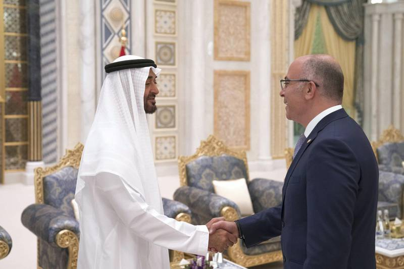 ABU DHABI, UNITED ARAB EMIRATES - May 20, 2018: HH Sheikh Mohamed bin Zayed Al Nahyan Crown Prince of Abu Dhabi Deputy Supreme Commander of the UAE Armed Forces (L), receives a foreign Ambassador, during an iftar reception at the Presidential Palace.   ( Hamad Al Kaabi / Crown Prince Court - Abu Dhabi ) ---