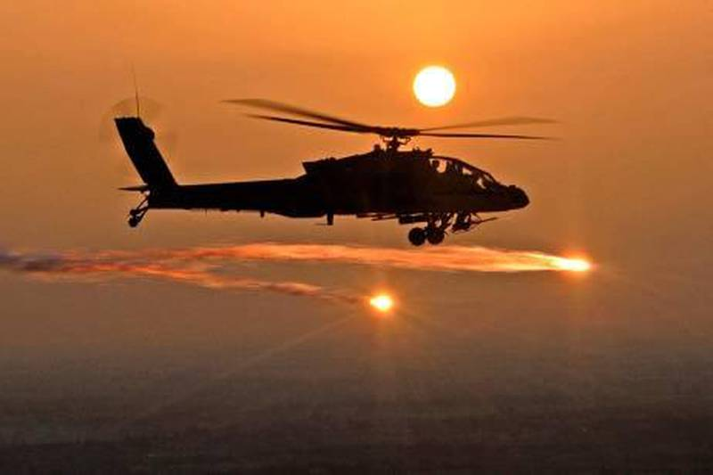 A picture released by the US military 07 June 2007, shows an AH-64D Apache helicopter firing flares as soldiers from the 227th Aviation Regiment, 1st Air Cavalry Brigade, 1st Cavalry Division, based at Camp Taji, conduct a mission over Iraq, 29 April 2007. At least 14 people were killed and 30 wounded today in two near simultaneous vehicle bombs north of Basra, the southern Iraqi city, police and medical officials told AFP. AFP PHOTO/HO/Chief Warrant Officer Daniel McClinton