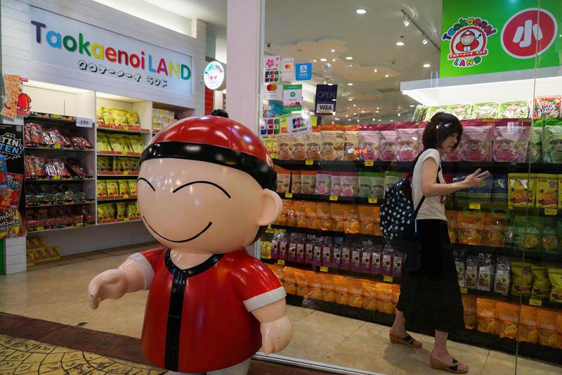 A tourist shops inside a Taokaenoi Land shop at a department store in Bangkok, Thailand, May 2, 2018. Picture taken May 2, 2018. REUTERS/Athit Perawongmetha