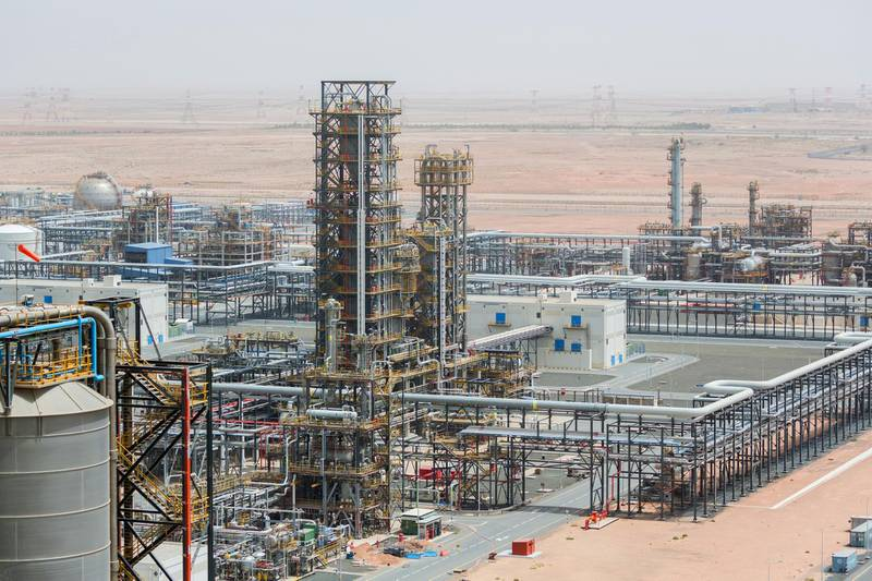 Cracking towers stand at the Ruwais refinery and petrochemical complex, operated by Abu Dhabi National Oil Co. (ADNOC), in Al Ruwais, United Arab Emirates, on Monday, May 14, 2018. Adnocis seeking to create world's largest integrated refinery and petrochemical complex at Ruwais. Photographer: Christophe Viseux/Bloomberg