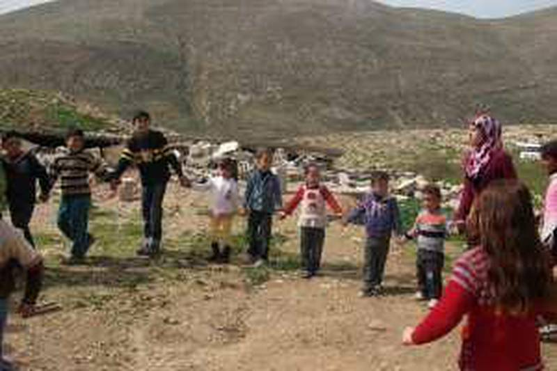 A group of young Palestinian children, some of whom saw their homes being destroyed by Israeli forces last month, are encouraged to relax, laugh and play by a team of UNICEF psycho-social workers at Khirbet Tana.