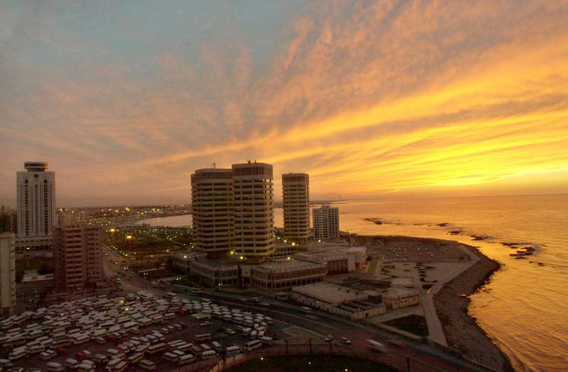 General view showing sunset over Tripoli city, Monday, March 1, 2004. (AP Photo/Amr Nabil)