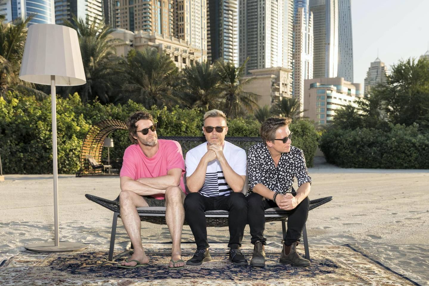 Take That (L-R Howard Donald, Gary Barlow and Mark Owen) are performing at the Dubai Media City Ampitheatre tonight. Picture by Mark Field