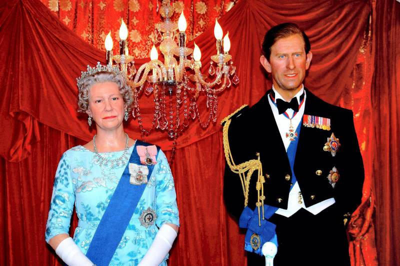 FBHAWW Hong Kong, China:  Madame Tussaud's Museum wax figures of Britain's Queen Elizabeth and Prince Charles