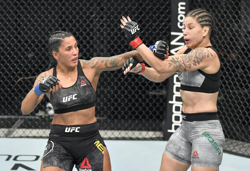 ABU DHABI, UNITED ARAB EMIRATES - JULY 12: (L-R) Vanessa Melo of Brazil punches Karol Rosa of Brazil in their bantamweight fight during the UFC 251 event at Flash Forum on UFC Fight Island on July 12, 2020 on Yas Island, Abu Dhabi, United Arab Emirates. (Photo by Jeff Bottari/Zuffa LLC)