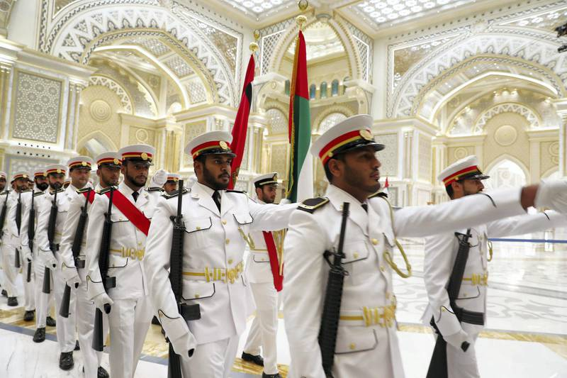 ABU DHABI , UNITED ARAB EMIRATES , October 15  – 2019 :- Members of the UAE Armed getting ready for the Vladimir Putin, President of Russia before the guard of honour at the Presidential Palace in Abu Dhabi.  ( Pawan Singh / The National )  For News. Story by John