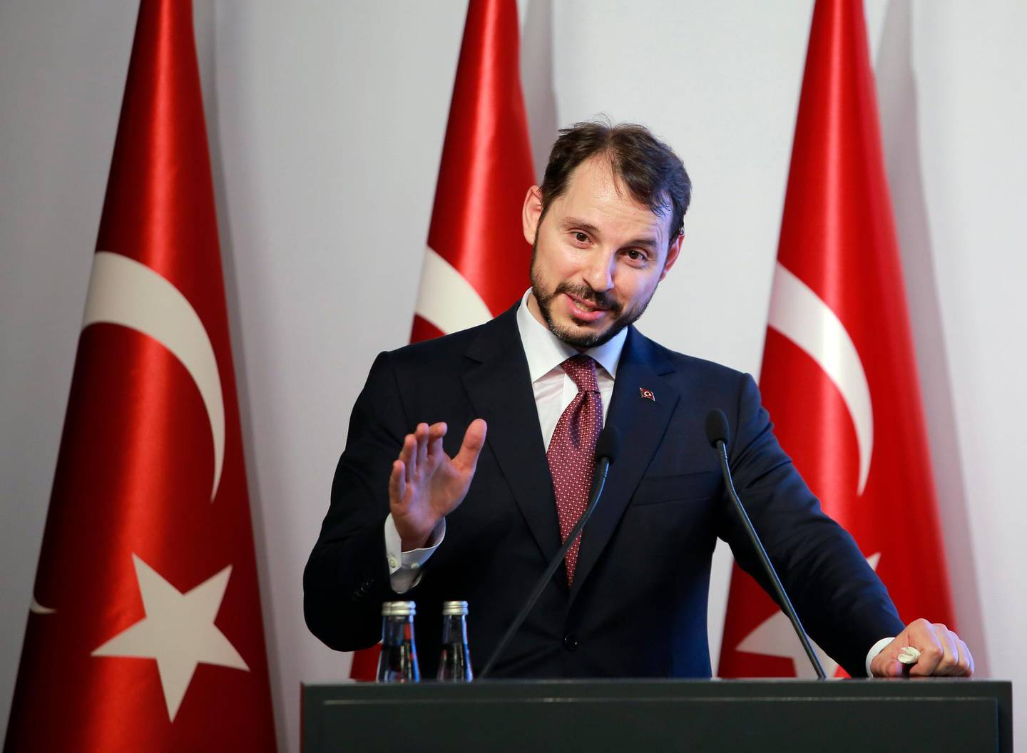 """Berat Albayrak, Turkey's Finance and Treasury Minister, son-in-law of President Recep Tayyip Erdogan, speaks about a """" new economic model """" in Istanbul, Friday, Aug. 10, 2018. Turkey was hit by a financial shockwave Friday as its currency nosedived on concerns about its economic policies and a dispute with the U.S., which President Donald Trump stoked further with a promise to double tariffs on the NATO ally. The lira hit a record low of 6.81 per dollar on Friday, before recovering to 6.51, tumbling more than 10 percent on the day. (AP Photo/Mucahit Yapici)"""