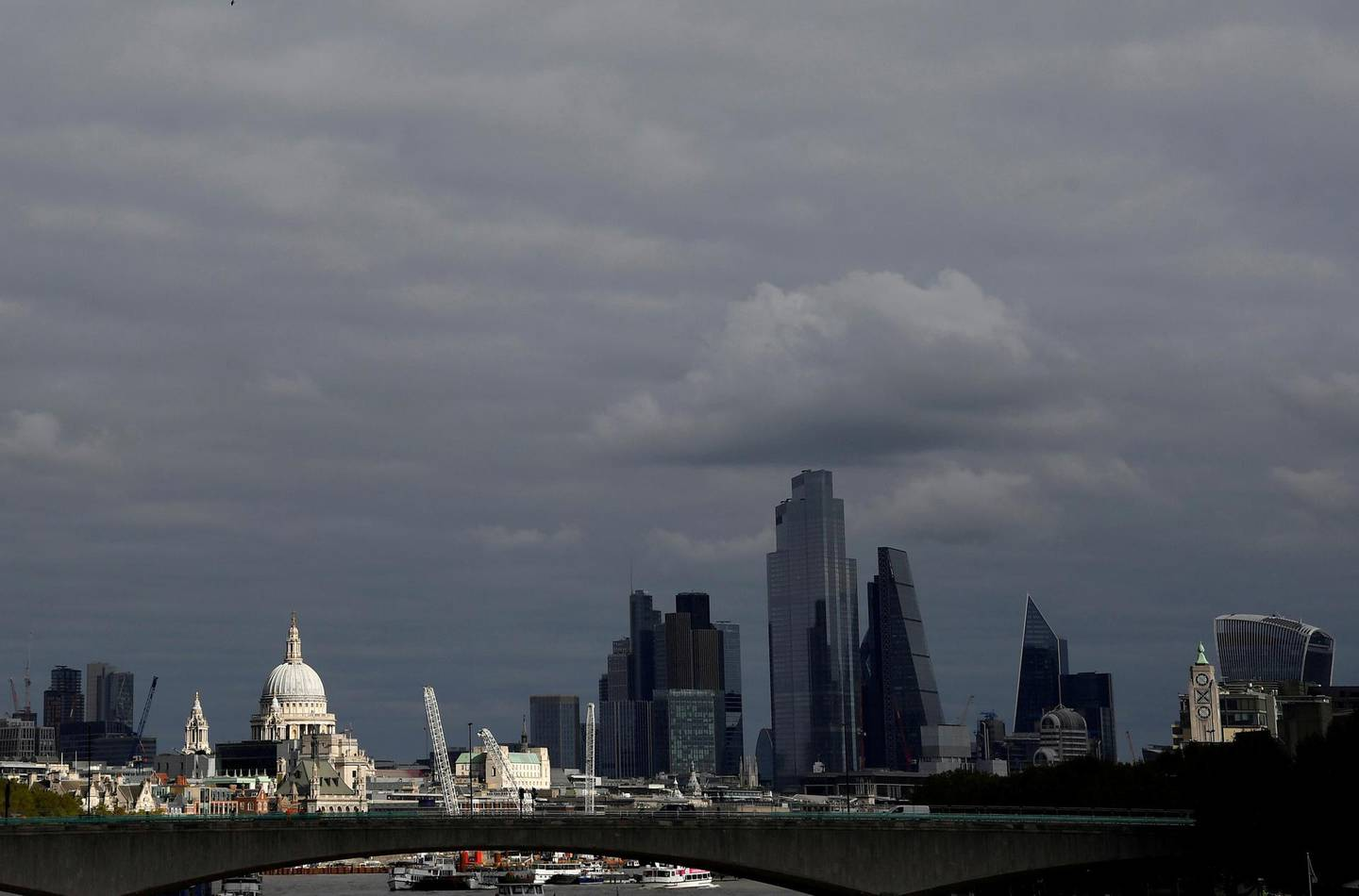 FILE PHOTO: St Paul's Cathedral is seen together with skyscrapers in the City of London financial district, Britain, October 16, 2020. REUTERS/Toby Melville/File Photo