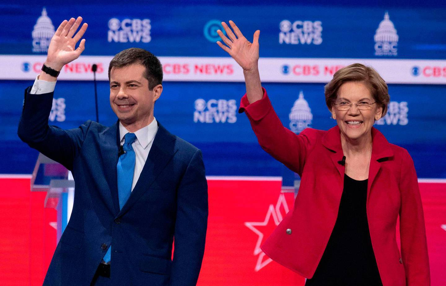 (FILES) In this file photo taken on February 25, 2020 former Democratic presidential hopefuls Former mayor of South Bend, Indiana, Pete Buttigieg and Massachusetts Senator Elizabeth Warren wave as they arrive on stage for the tenth Democratic primary debate of the 2020 presidential campaign season co-hosted by CBS News and the Congressional Black Caucus Institute at the Gaillard Center in Charleston, South Carolina. Elizabeth Warren, once a frontrunner in the Democratic contest for the White House, is dropping out of the race, US media reported Thursday, following a poor showing in several statewide votes this week. Warren, a 70-year-old progressive senator from Massachusetts, will hold a call with her campaign staff Thursday and announce that she is suspending her bid for the party's presidential nomination, a source familiar with the plans told CNN.  / AFP / JIM WATSON