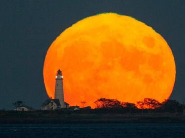 The Harvest Moon glows around the world - in pictures
