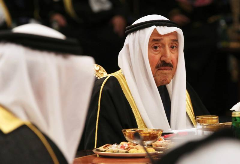 Kuwait's emir, Sheikh Sabah Al Ahmad Al Sabah, presides over the Gulf Cooperation Council summit in Kuwait City, Tuesday, Dec. 5, 2017. Kuwait hosted a meeting Tuesday of the Gulf Cooperation Council that saw Qatar's ruling emir attend, but other rulers stayed away amid the ongoing boycott targeting Doha. (AP Photo/Jon Gambrell)