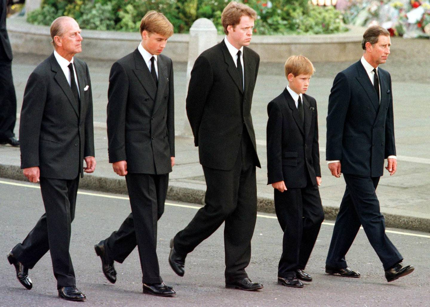 """(FILES) In this file photo taken on September 06, 1997 (L-R) Britain's Prince Philip, Duke of Edinburgh, Britain's Prince William, Earl Spencer, Britain's Prince Harry and Britain's Prince Charles, Prince of Wales follow the coffin of Diana, Princess of Wales, to Westminster Abbey in London for her funeral service.   Princes William and Harry hit out at the BBC and journalist Martin Bashir over """"the deceitful way"""" Bashir obtained his explosive TV interview with Princess Diana, their late mother, in which she detailed her troubled marriage to Prince Charles. / AFP / POOL / JEFF J MITCHELL"""