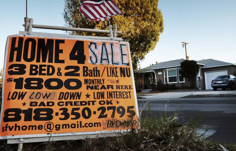 FILE - This Jan. 17, 2015 photo shows a sign advertising a house for sale in Los Angeles. Analysis by Reveal from The Center for Investigative Reporting found Latinos accounted for nearly half of the population in the Los Angeles area in 2015-2016, yet made up just 18 percent of conventional loan applications. (AP Photo/Richard Vogel, File)