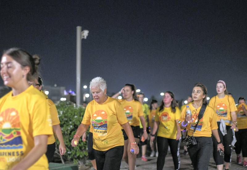 Abu Dhabi, United Arab Emirates - This year 1,700 people took part in the ÔDarkness into LightÕ walk at Emirates Palace. Khushnum Bhandari for The National
