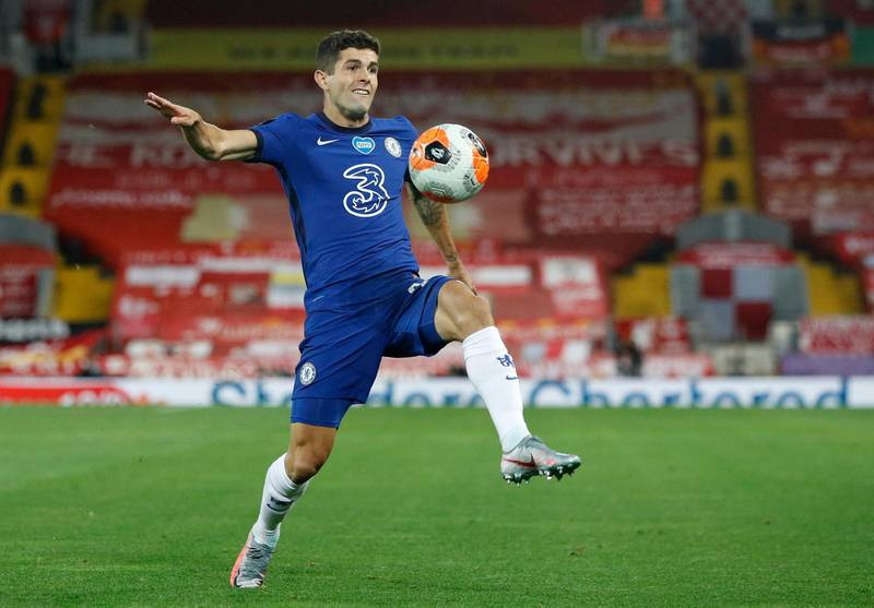 FILE - In this Wednesday, July 22, 2020 file photo, Chelsea's Christian Pulisic controls the ball during the English Premier League soccer match between Liverpool and Chelsea at Anfield Stadium in Liverpool, England. Frank Lampard's squad has certainly seen the most intriguing changes ahead of the new campaign - having been banned from signing players last summer, they have looked to make up for lost time and recruited some big names to replace long-term servants such as Pedro and Willian. (Phil Noble/Pool via AP, file)